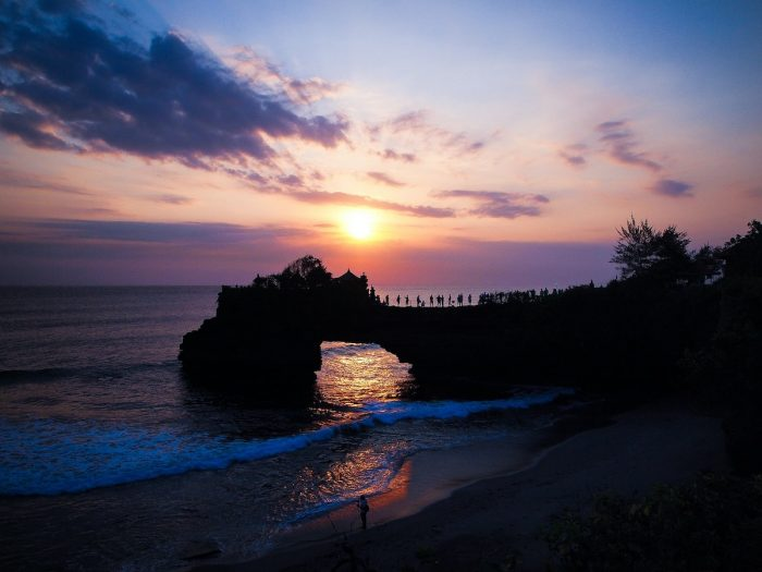 Sunset at Tanah Lot Temple by Bckfwd via Unsplash
