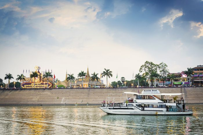Tourist boat on sunset cruise in Phnom Penh Cambodia Mekong River photo via Depositphotos