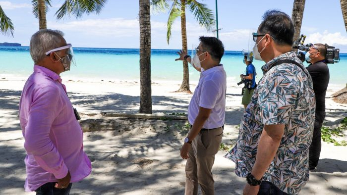 Department of Tourism (DOT) Assistant Secretary Roberto Alabado III, together with Department of Tourism (DOTr) Undersecretary Artemio Tuazon Jr. and Civil Aviation Authority of the Philippines (CAAP) Deputy Director General Donald Mendoza conduct an inspection of health and safety protocols in one of the beachside restaurants in D'Mall, Boracay.