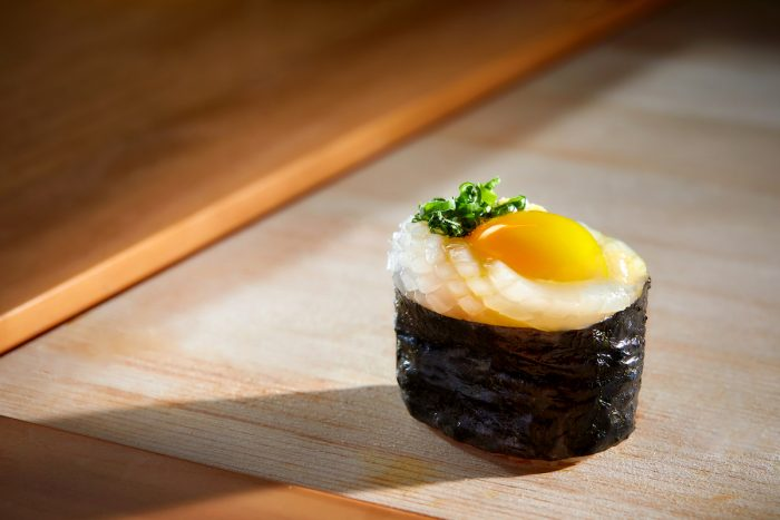 Chef Makoto's specialty sushis include fresh and sweet squid Ika and Quail Egg Yolk Sushi