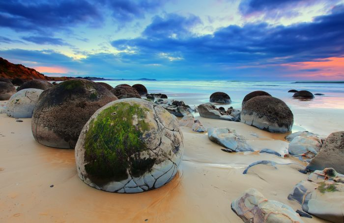 Cloudy Sunrise at Moeraki Boulders, New Zealand via Depositphotos