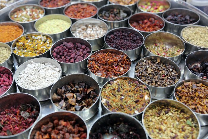 Different spices and herbs in metal bowls on a street market in Kolkata, India via Depositphotos