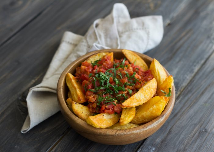 Patatas Bravas, traditional Spanish tapas photo via Depositphotos