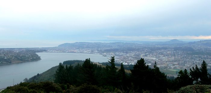 The view looking south across central Dunedin and the head of the Otago Harbour, from the New Zealand Centennial monument on Signal Hill by Grutness via Wikipedia CC