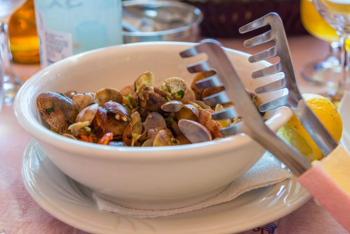 Fresh mussels in bowl on table in restaurant, Albania photo via Depositphotos