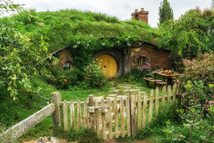 Hobbit holes in hobbiton photo via Depositphotos