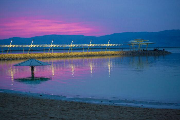 Magic lilac sunrise at the Dead Sea photo via Depositphotos