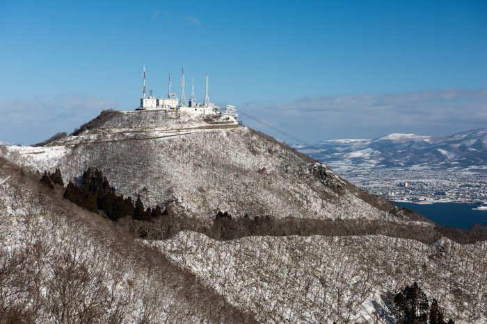Mt. Hakodate, Hokkaido, Japan observation area and ropeway on the peak in winter. photo via Depositphotos