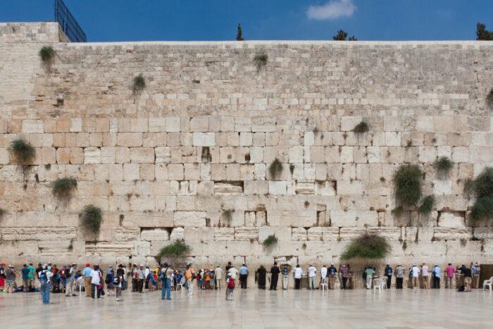 People pray at the western wall, Jerusalem photo via Depositphotos