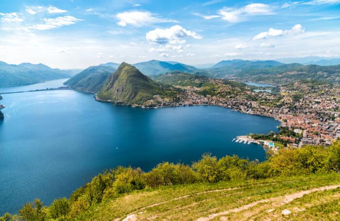 Scenic view of lake Lugano with Monte San Salvatore and Lugano town from Monte Bre, Ticino, Switzerland photo via Depositphotos
