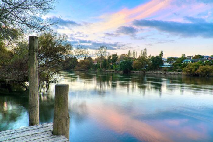 Sunset along the Waikato River in Hamilton, New Zealand photo via Depositphotos