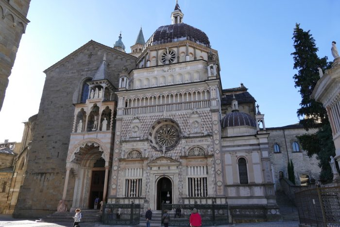 Bergamo - Cathedral facade in white marble by Botticino and Colleoni Chapel photo via Depositphotos
