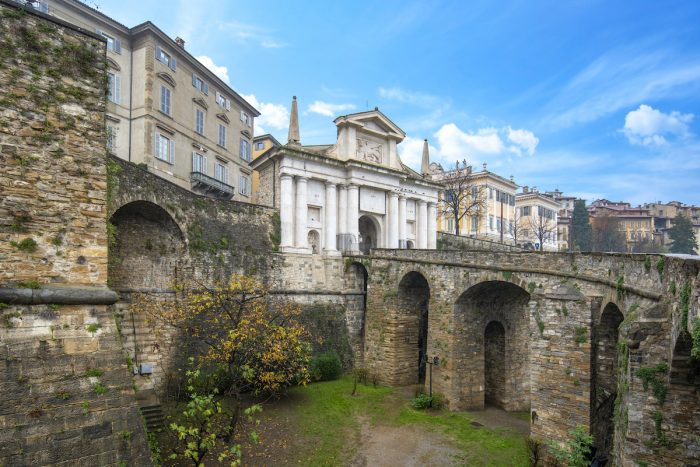 Bridge and the gate Porta San Giacomo in Bergamo, Italy on the Venetian Walls photo via Depositphotos