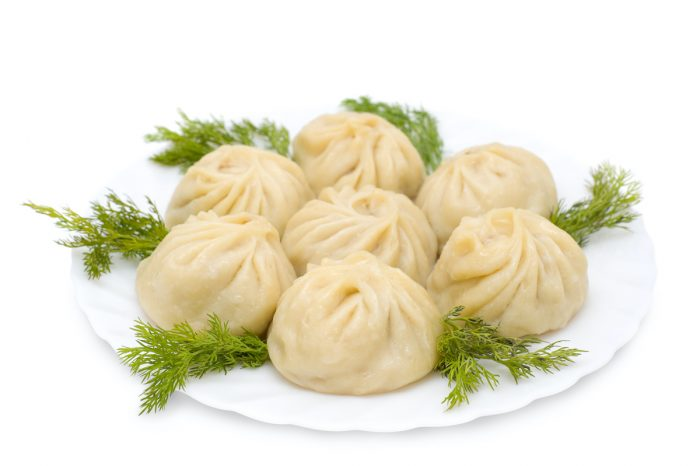 Buuz is a type of Mongolian steamed dumpling filled with meat photo via Depositphotos