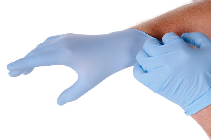 Latex protective gloves photo via Depositphotos