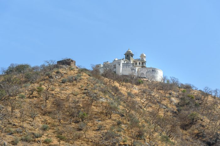 Monsoon Palace or Sajjan Garh Palace on the hill in Udaipur. India photo via Depositphotos