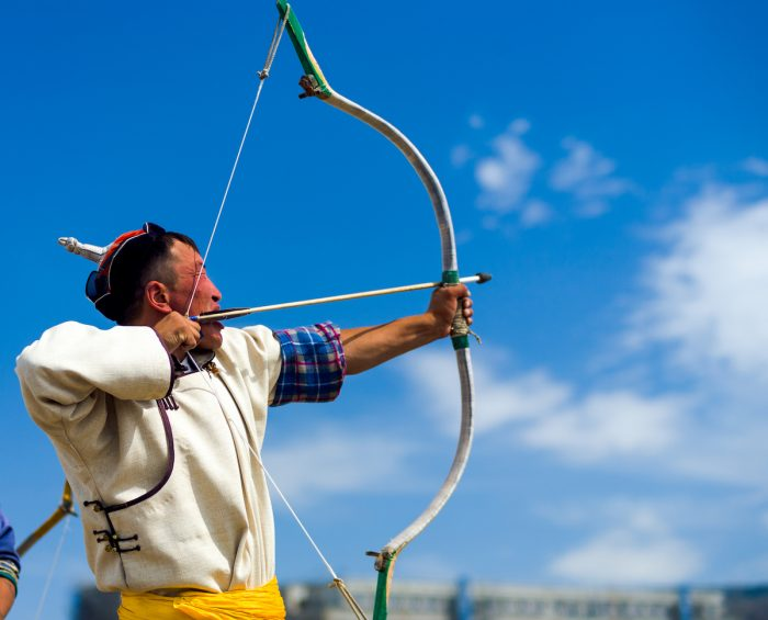Naadam Festival Archery Man Pulling Bowstring Aim photo via Depositphotos