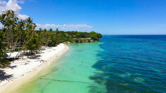 Sandy beach in Panglao island - Bohol Travel Requirements photo via Depositphotos