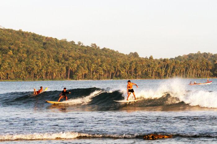 Surfing in Nias photo via Depositphotos