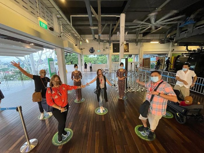 Filipino attendees practice social distancing as they wait in line at the Mt. Faber Cable Car Station. Shown in photo are (L-R): Cuki Pendor, VP for Sales and Marketing, Step Up International Services Inc., Dolly Santos, President, Golden Sky Travel and Tours; Dorothy Aytona, President, Skynet Travel Corp., and Ritchie Tuaño, General Manager of Asia Reps Travel Services Inc.