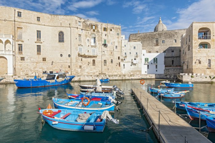 View of Monopoli harbor with fishing boats, Apulia, Italy. photo via Depositphotos
