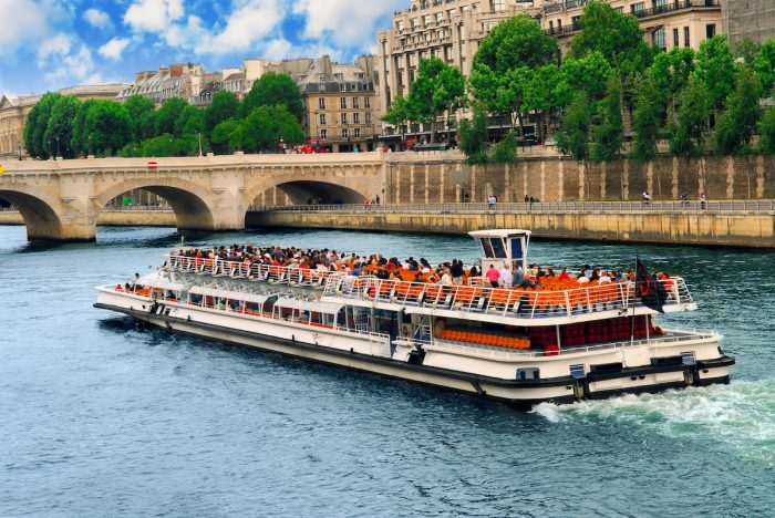 Boat tour on Seine photo via Depositphotos