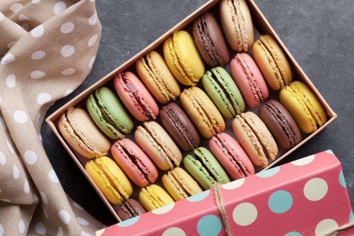 Colorful macaroons in box photo via Depositphotos