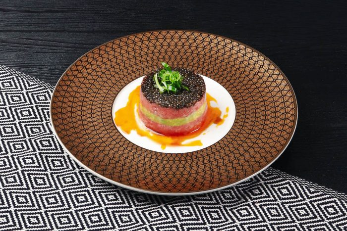 "Chef Yusuke Kitade's ""reimagined"" traditional izakaya cuisine with a Midas touch for specialties including Fatty Tuna Tartare with Avocado Paste, Marinated Egg Yolk, topped with caviar"
