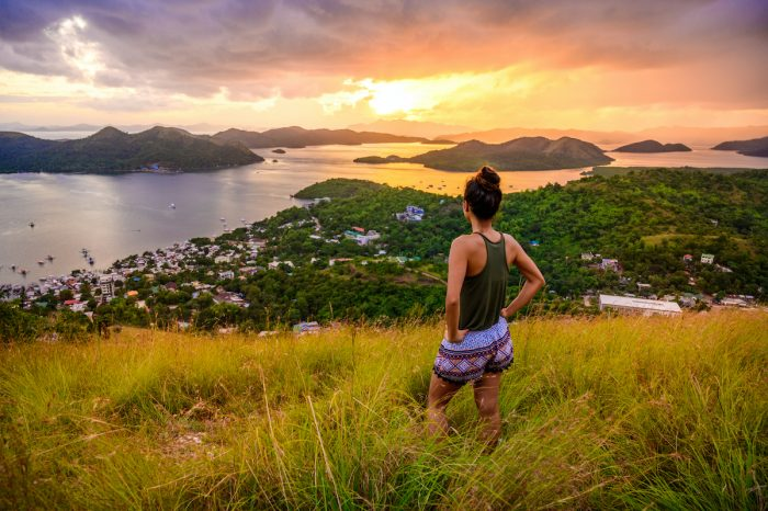 Girl looking over Coron Town and Bay from Mount Tapyas photo via Depositphotos