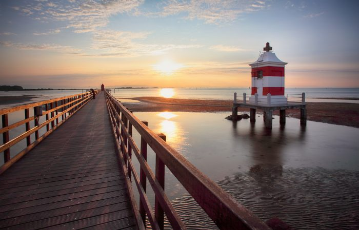 Lignano Sabbiadoro Lighthouse photo via Depositphotos