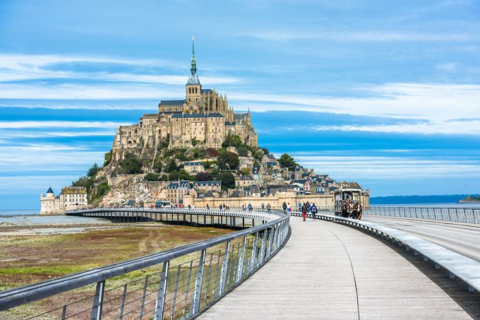 Mont-Saint-Michel, island with the famous abbey, Normandy, France photo via Depositphotos