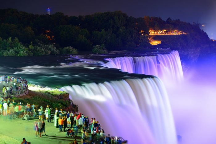Niagara Falls lit at night photo via Depositphotos