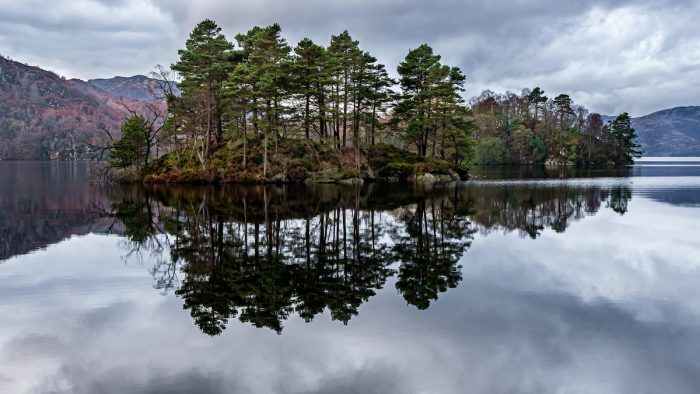 Reflections of Loch Katrine, Scotland photo via Depositphotos
