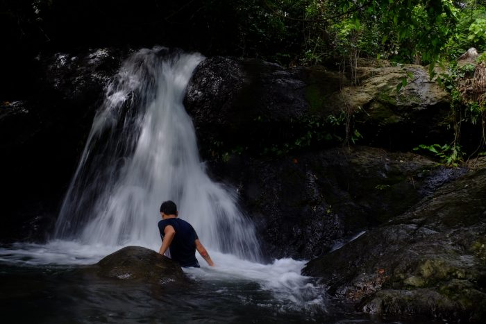 Taking a dip in the cool waters of Turayog Falls. Photo by Ramir G. Cambiado