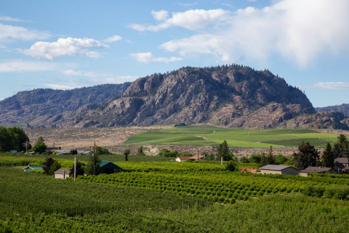 View on the farm lands during a cloudy summer day. Taken in Osoyoos photo via Depositphotos