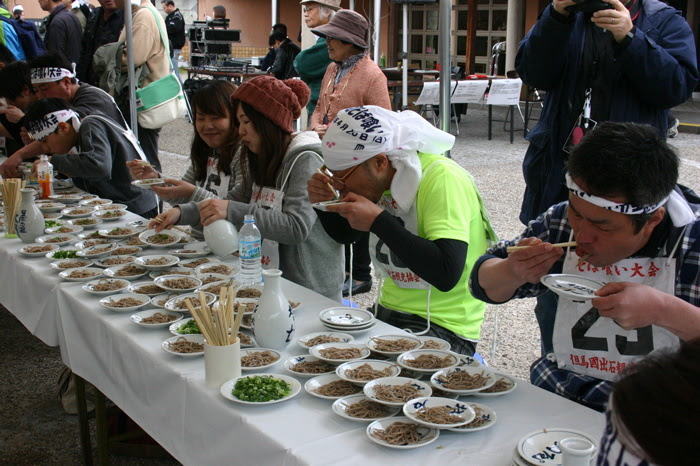 Competitors eating their weight at the annual soba-eating tournament