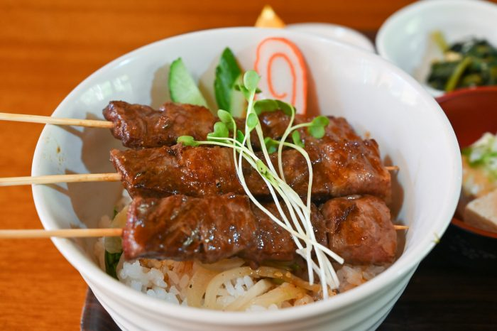 Hida beef skewer on rice photo via Depositphotos