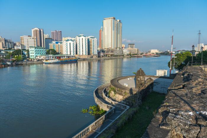 Fort Santiago and buildings along the Pasig River photo via Depositphotos