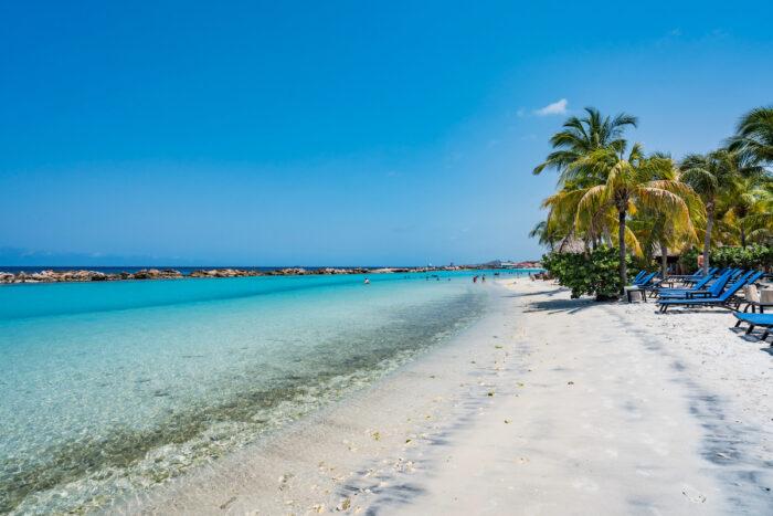 Mambo Beach on the Caribbean Island of Curacao photo via Depositphotos