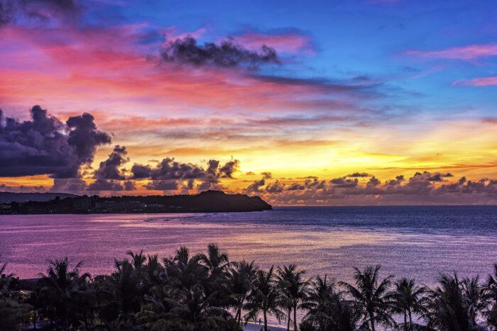 Sunset at Tumon Bay in Guam photo via Depositphotos