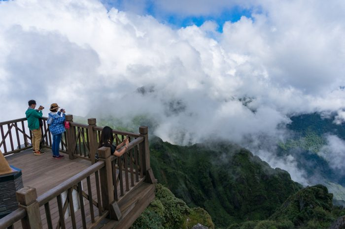 Tourists enjoying the view from observation deck on Fansipan Mountain photo via Depositphotos