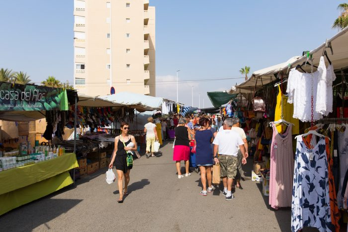 Spanish street market busy with people buying and selling at La Mata, Torrevieja, Spain photo via Depositphotos