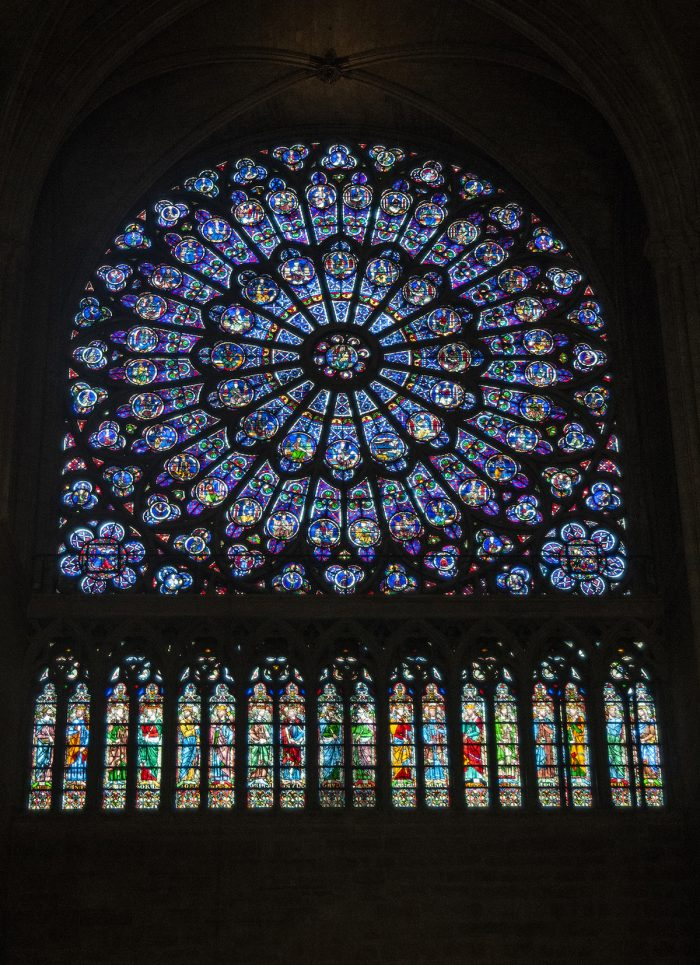 The stained glass rose window is one of the characteristics of Gothic architecture which brings light into the enormously tall interiors.