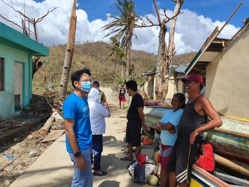 UNICEF-WASH Officer Geo Lapina canvassing the situation from the families living in the coastal areas of Baras after Typhoon Rolly which severely hit the area in November 2020.